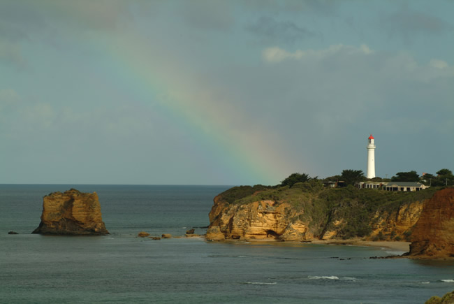 Natural spotlight on the cliff face at Split Point Lighthouse, Aireys Inlet, Great Ocean Road, Victoria, Australia