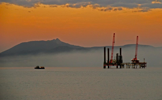 Platforms at sea with a morning mist to give a soft view. Gladstone Harbour, Queensland, Australia