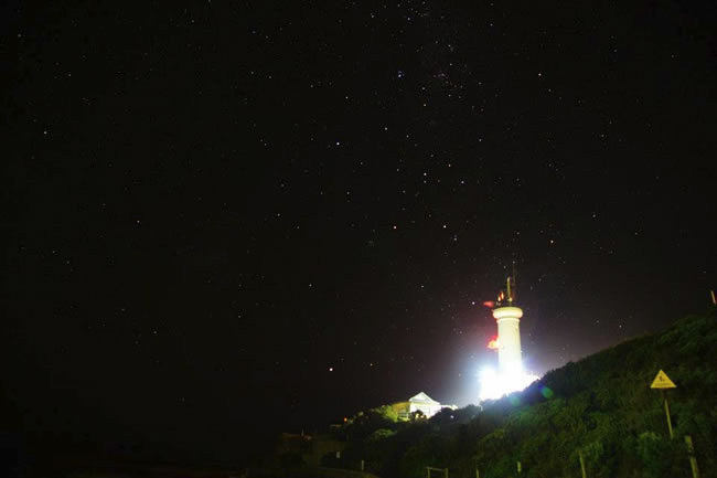 A lit up Point Lonsdale Lighthouse, with a starry night sky as a background, Bellarine Peninsula, Victoria, Australia