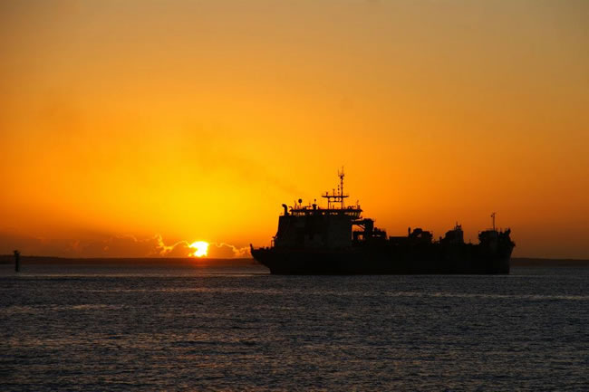 The dredge 'Rotterdam' underway at dawn. Gladstone Harbour, Queensland, Australia