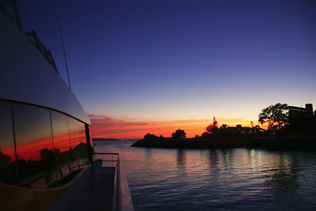 Sailing into a red dawn. Gladstone Harbour, Queensland, Australia