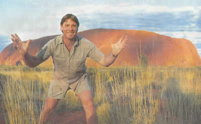 Steve Irwin, with all his enthusiasm evident, near Uluru, or Ayers Rock, Northern Territory, Australia
