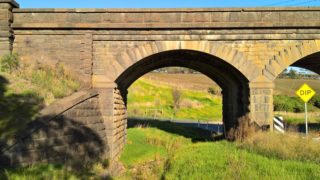 Detail of old stone railway bridge at Lovely Banks, near Geelong, Victoria, Australia