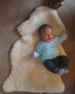 Baby on a single sheepskin baby rug
